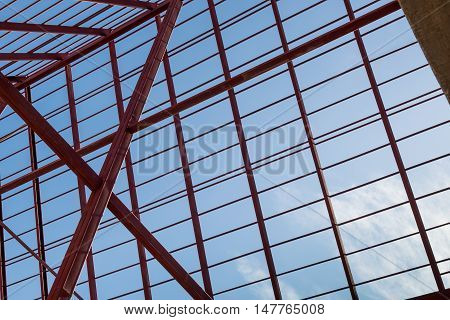 Structural steel beam on roof of building residential construction.