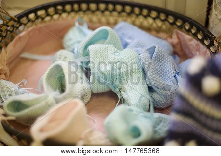 Basket of tiny hand kitted baby booties