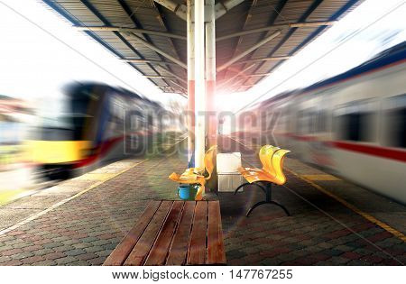 Empty train station with fast moving trains