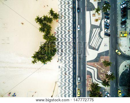 Top View of Copacabana beach with mosaic of sidewalk in Rio de Janeiro, Brazil