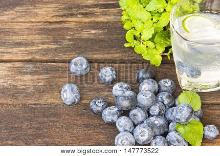 Drink Detoxification,blueberry and lemonade water.Fruit and health.Close up.