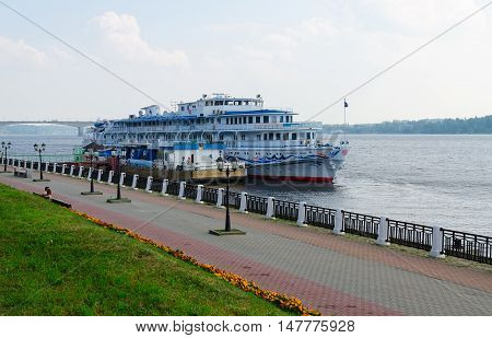 KOSTROMA RUSSIA - JULY 20 2016: Unidentified people are relaxing on waterfront near cruise ship