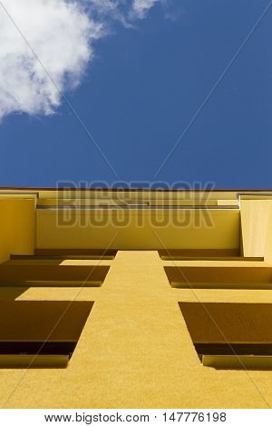 Low angle view to fragment of modern apartment building exterior