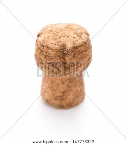 wooden cork from champagne bottle on a white backrgound