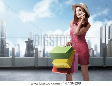 Shopping Time, Beautiful Asian Woman With Hat Talking On The Phone