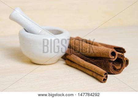 Cinnamon Sticks And Powder On Wood Background