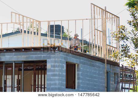 Timber framed two storey house with masonry block under storey