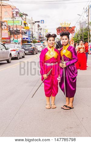 Phuket Thailand - Aug 26 : Unidentified beautiful girls leader of parade of various schools in Phuket province on opening ceremony of yearly provincial sport. Both of them wearing as two heroines called
