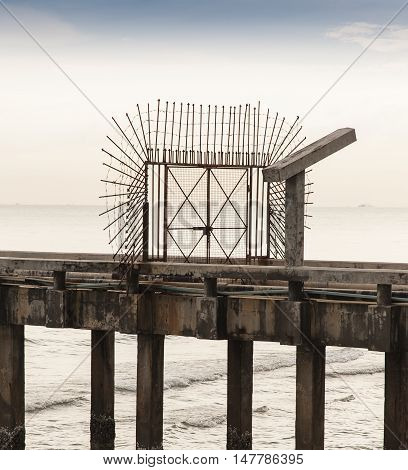 Defensive Gate Used On Military Docking Pier Consisting Of Barbed Wire And Spiked Railings, With Bea