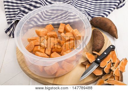 prepared potatoes in a food steamer insert kitchen knife and peel