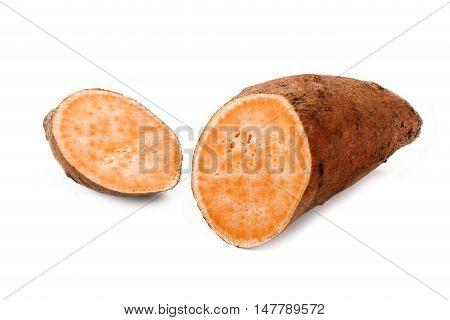 one cut through sweet potato isolated on white background