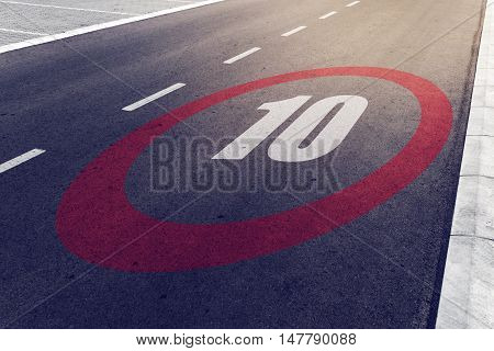 10 kmph or mph driving speed limit sign on highway road safety and preventing traffic accident concept.