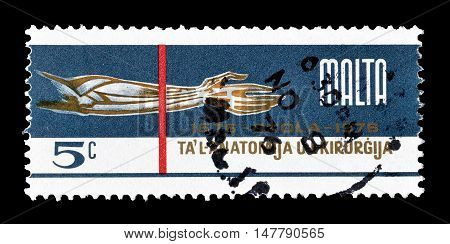 MALTA - CIRCA 1976 : Cancelled postage stamp printed by Malta, that shows Dissected arm and hand.