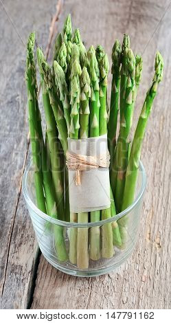 Young asparagus on wooden tables close up .