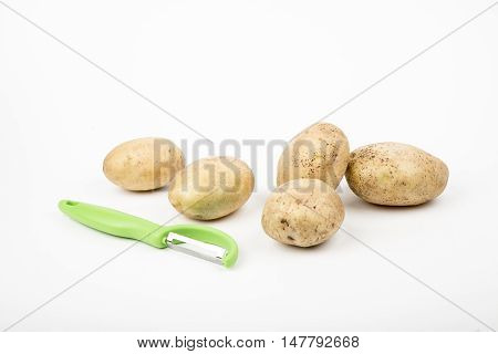 fresh raw potatoes on a white background