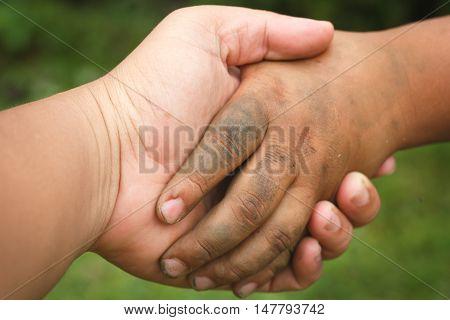 Close up of Dirty boy's hand make handshake.