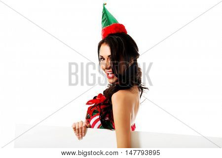 Woman wearing elf clothes with white banner