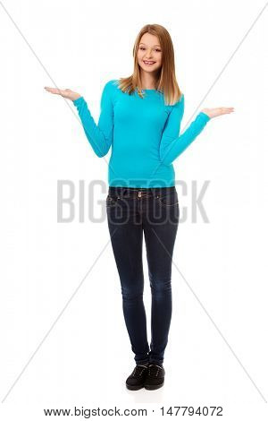 Confused woman shrugging with palms up