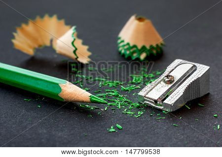 Sharpener, Green Wooden Pencil And Pencil Shavings On Black