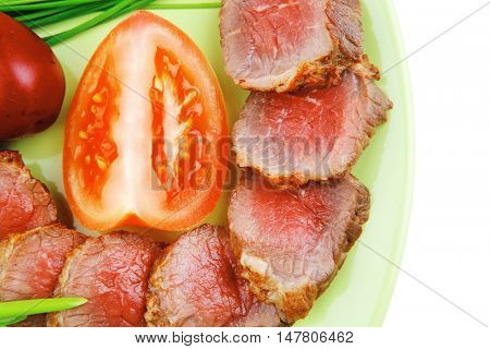 meat food : grilled fat meat served on green plate with tomatoes and sprouts isolated on white background