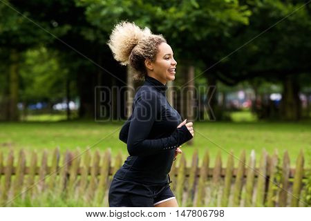 Female Runner Outside Smiling