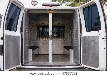 inside a police car. Open doors of a police van.