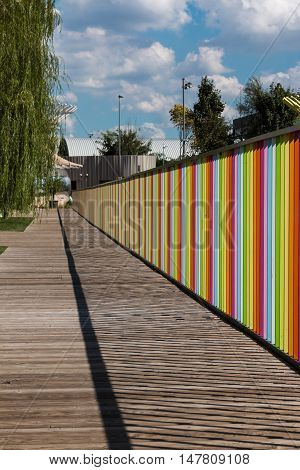 Wooden Deck with Colorful Fence near Children Playground
