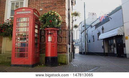 Red public telephone box and letter box in Fore Street Sidmouth