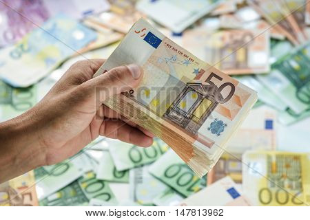 cash in man hand closeup