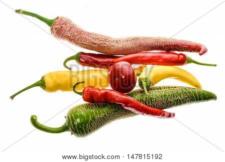 Different Variety Of Hot Peppers Or Chilies, Isolated On White.