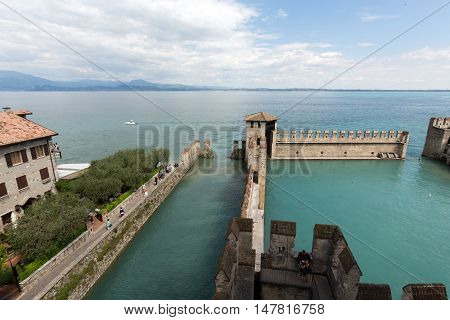 SIRMIONE ITALY - MAY 5, 2016: Backwater inside the Scaliger Castle - medieval port fortress Sirmione Italy