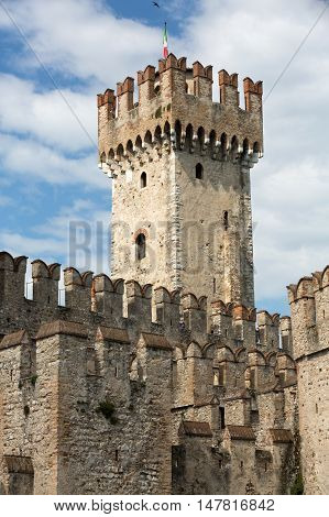 SIRMIONE ITALY - MAY 5, 2016: Medieval castle Scaliger in old town Sirmione on lake Lago di Garda. Italy