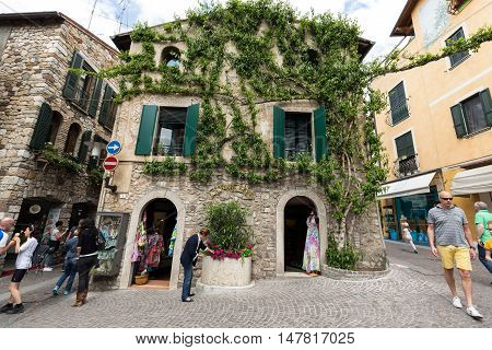 SIRMIONE ITALY - MAY 5, 2016: Old house covered by ivy in Sirmione on Garda Lake Italy