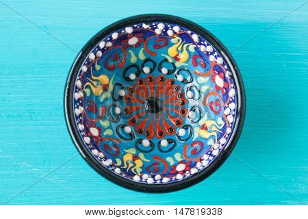 Turkish traditional bowl on a turquoise background