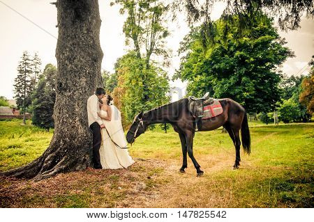 Happy Bride And Groom On Horseback In The Forest, Beautiful Nature