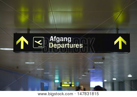 Departures sign at an airport