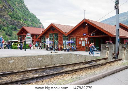 FLAM NORWAY - JUNE 27 2013: The railway station in Flam village in Norway. Flam is located at the extremity of Norway's longest fjord named Sognefjord. The touristic trains start from here.