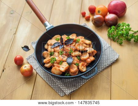 Homemade gnocchi with tomato sauce