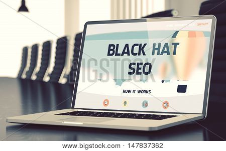 Closeup Black Hat SEO Concept on Landing Page of Laptop Screen in Modern Meeting Room. Toned Image. Selective Focus. 3D Illustration.