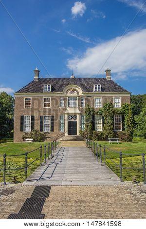DALFSEN, NETHERLANDS - AUGUST 31, 2016: Bridge to the old dutch mansion Huis Den Berg in Dalfsen, Holland