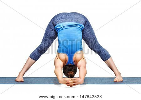 Beautiful sporty fit woman practices Ashtanga Vinyasa yoga asana Prasarita padottanasana C - wide legged forward bend C isolated on white