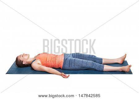 Beautiful sporty fit yogini woman relaxes in yoga asana Savasana - corpse pose in studio isolated on white