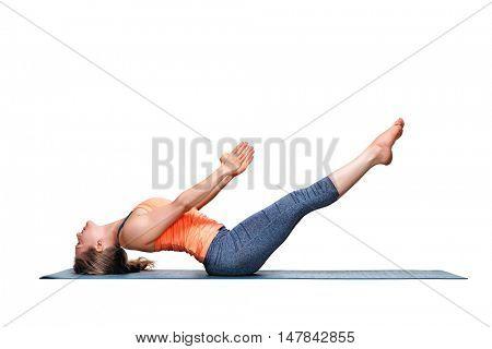 Beautiful sporty fit woman practices Ashtanga Vinyasa Yoga asana Uttana padasana - raised legs pose isolated on white