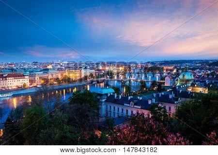 Travel Prague concept background - elevated view of bridges over Vltava river from Letn�¡ Park. Prague, Czech Republic in twilight