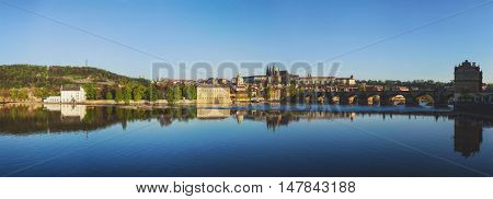 Panorama view of Charles bridge over Vltava river and Gradchany (Prague Castle) and St. Vitus Cathedral in the morning, Prague, Czech Republic