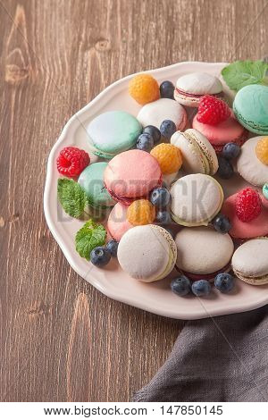 Traditional French Sweets. Assorted Colorful Macaroons With Mint