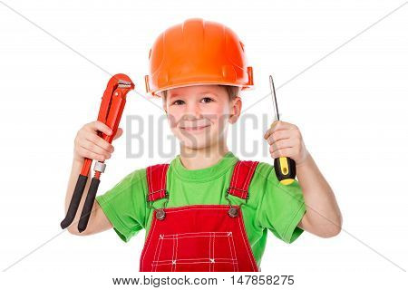 Little builder in red coveralls and helmet with wrench and screwdriver, isolated on white