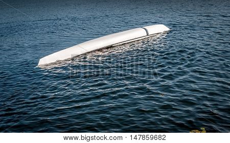 man rolling with a kayak on a lake - serial pictures 9 of 11