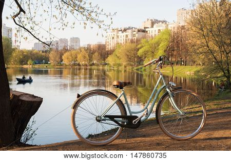 Nice and beautiful bicycle in a city park summer on pond