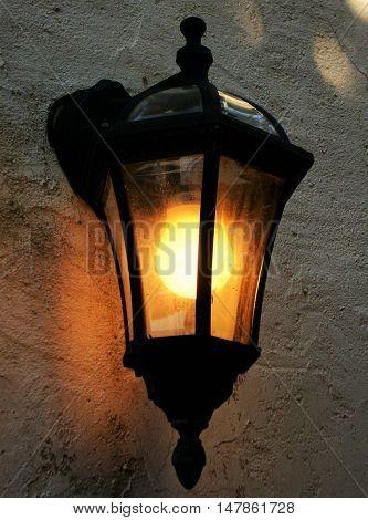 Retro street wall lamp with yellow orange light